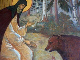 Saint Serge de Radonège et l'ours - fresque de la porte d'entrée de la Laure de la Trinité-Saint-Serge